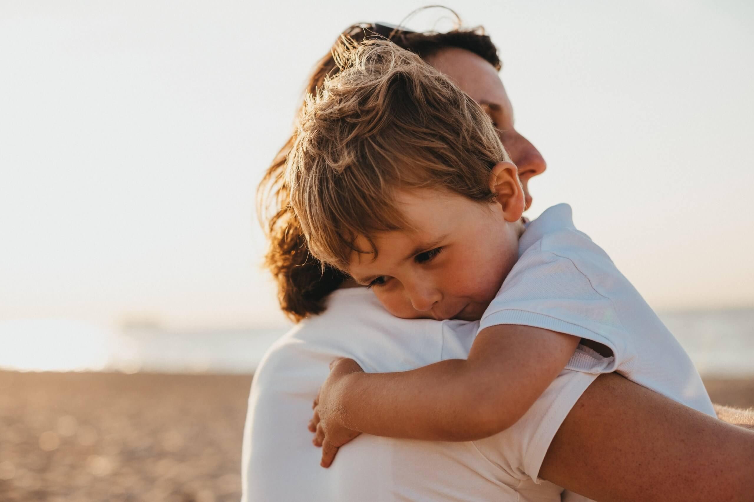 Child hugging parent